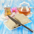 Tasty halva with tea on table — Stock Photo