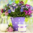 Beautiful bouquet in pail on wooden table on natural background — Stock Photo #28767787