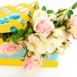 Yellow gift box with flowers isolated on white — ストック写真