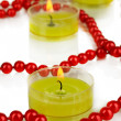 Lighted candles with beads close up — Stock Photo #28767979
