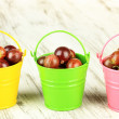 Stock Photo: Fresh gooseberries in buckets on table close-up