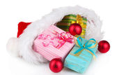 Beautiful Christmas hat with gifts and Christmas balls isolated on white — Stock Photo