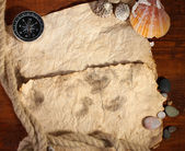 Old paper, compass and rope on a wooden table — Stock Photo