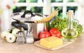 Ingredients for cooking pasta on table in kitchen — Stock Photo