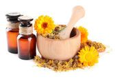 Medicine bottles and calendula flowers in wooden mortar isolated on white — Stock Photo