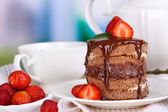 Chocolate cake with strawberry on wooden table on room background — Stock Photo