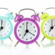 Colorful alarm clock isolated on white — Stockfoto