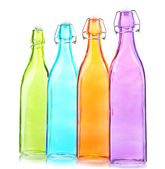 Empty color glass bottles, isolated on white — Stock Photo