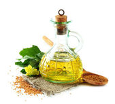 Jar of mustard oil and seeds with mustard flower, isolated on white — 图库照片