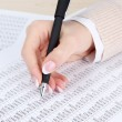 Closeup of businesswoman hand, writing on paper — Stock Photo