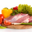 Raw meat and vegetables on a wooden board isolated on white — Stock Photo #28796487