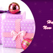 Colorful purple gifts with Christmas balls isolated on white — Stock Photo