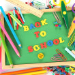 Small chalkboard with school supplies on white background. Back to School — Стоковая фотография