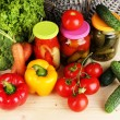Fresh vegetables and canned on wooden table close up — Stock Photo #28799743