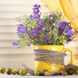 Stock Photo: Beautiful bouquet of wildflowers in cup and berries on wooden table