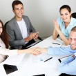 Business team working on their project together at office — Stock Photo #28800695