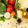 Fresh vegetables in basket on wooden table close-up — Stock Photo #28802537