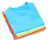 Neatly folded shirts isolated on white — Stock Photo