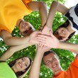 Happy group of young people in park — Stock Photo