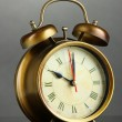 Old alarm clock  on gray background — Stock Photo