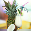 Pina colada drink in cocktail glass, on bright background — Stock Photo #28833631