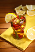 Iced tea with raspberries and mint on wooden table — Stok fotoğraf