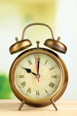 Old alarm clock on bright background — Foto de Stock