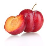 Ripe plums isolated on white — Stock Photo