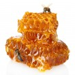 Stock Photo: Sweet honeycomb with honey and bee, isolated on white