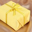 Romantic parcel on gold cloth background — Stock Photo #28911675