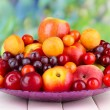 Assortment of juicy fruits on wooden table, on bright background — Stock Photo #28912645