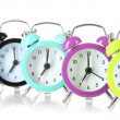 Colorful alarm clock isolated on white — Stock Photo