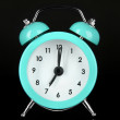 Blue alarm clock on dark grey background — Stock Photo