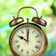Old alarm clock  on bright background — Stock Photo