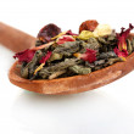 Green dry jasmin tea in woooden spoon isolated on white — Stock Photo #28916713