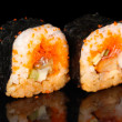 Stock Photo: Delicious sushi on black background