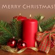 Two candles and Christmas decorations, on brown background — Stock Photo #28916907