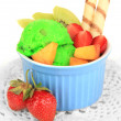 Stock Photo: Delicious ice cream with fruits and berries in bowl isolated on white