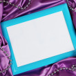 Empty frame on beautiful silk background — Stock Photo #28917771