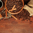 Coffee beans, metal turk and coffee mill on wooden background with copy space — Stock Photo