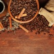 Coffee beans, metal turk and coffee mill on wooden background with copy space — Stock Photo #28918855