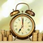 Alarm clock on table on light background — Stock Photo #28919417