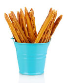 Tasty crispy sticks in blue pail isolated on white — Stock Photo