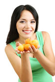 Girl with fresh apricots isolated on white — Stock Photo