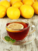 Cup of tea with lemon on table close-up — Stock Photo