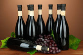 Wine bottles on brown background — Stock Photo