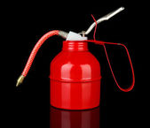 Red oil can, isolated on black — Stock fotografie