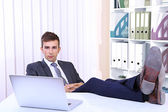 Businessman resting at his office with his shoes on table — Stockfoto