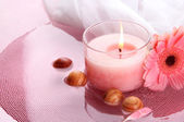 Beautiful pink candle with flower in water — Stock Photo