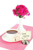 Beautiful bouquet of phlox with cup of tea isolated on white — Stock Photo